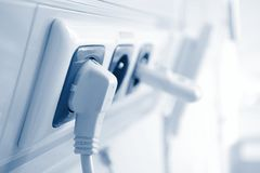 Electricity. Electric plug in a socket Royalty Free Stock Photo