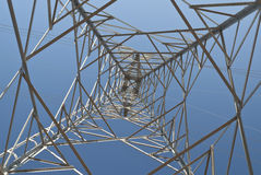 Electricity. Pylon against a blue sky Royalty Free Stock Photography
