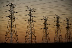 Electricity. Electrical power lines at dusk Stock Photo
