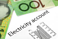 Electricity Account with Australian Money. Electricity account showing increasing usage and greenhouse gas emissions, with Australian one hundred dollar bills