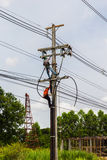 Electricity Authority. On electricity post to repair a cable Stock Photo