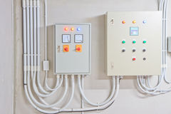 Electricity box. Electricity distribution box. Fusebox. On white wall background royalty free stock photo
