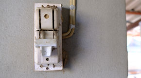 Electricity breaker installed on cement wall Stock Photo