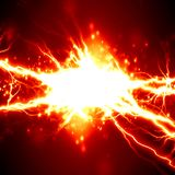 Electricity. Bright electrical spark on a dark red background Royalty Free Stock Image