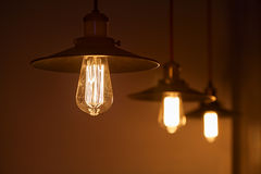 Electricity. Bulb Edison bright light Stock Images
