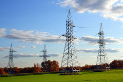 Electricity cable communication towers Stock Photography