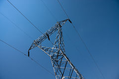 Electricity Cables. Electricity pylon tower against blue sky Royalty Free Stock Photo