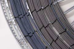 Electricity cables. A bundle of electricity cables bent around a corner stock images