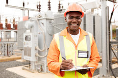 Electricity company worker. Portrait of african american electricity company worker in substation Stock Image