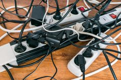 Electricity consumption concept. Many cables of electrical home appliances. Stock Photos