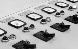 Electricity control panel. With clocks measuring and controlling electricity and buttons stock photos