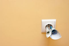 Electricity cost. Abstract with socket in the wall with euro banknotes stuck in royalty free stock photos