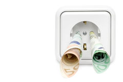 Electricity Costs (Front View). Banknotes attached to a power socket. Isolated on a white background stock photo