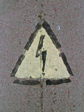 Electricity danger sign on stone, power, Royalty Free Stock Photography
