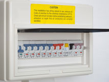 Electricity distribution box. With circuit breakers and note of caution yellow sticker royalty free stock image