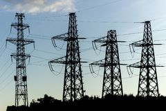 Electricity distribution with high voltage power lines stock photo