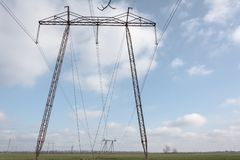 Pillars of high voltage in Moldova. Electricity distribution. Pillars of high voltage in the Moldavian landscape Stock Photos