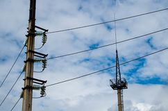 Electricity distribution station. Lots of wires, poles and shields royalty free stock images