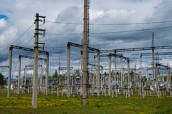Electricity distribution station. Lots of wires, poles and shields royalty free stock photo