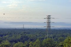 Electricity distribution tower in the Atlantic Forest. Electricity distribution tower in the middle of the Atlantic Forest. Cubatao, Sao Paulo state, Brazil stock image