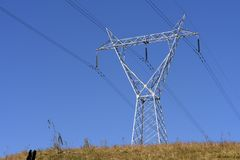 Electricity distribution tower on top of hill. Brazil stock photo
