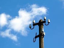 Electricity distribution wooden post with no cables under blue sky royalty free stock images