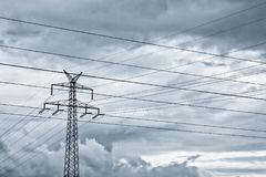 An electricity. Mast on dark clouds stock photos