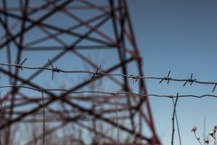 Electricity. Fence. Spines. Tower. Blue sky. royalty free stock photo
