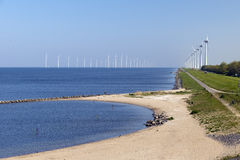 Electricity generating mills. Off the coast of Urk in the Netherlands royalty free stock photo