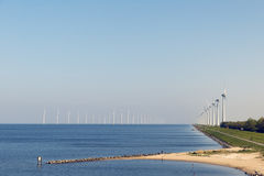 Electricity generating mills. Off the coast of Urk in the Netherlands stock photos