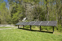 Electricity Generating Solar Energy Panels. Some electricity generating solar energy panels in a wooded area Stock Photos