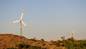 Electricity generating Windmills in desert Royalty Free Stock Photos