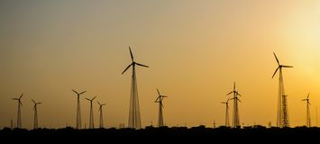 Electricity generating Windmills in desert Stock Photos