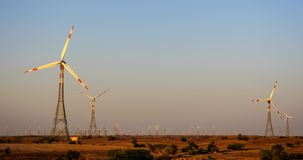 Electricity generating Windmills in desert Royalty Free Stock Images