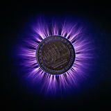 Electricity and German Euro coin stock photography