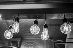 Electricity in glowing bulbs. Electricity and energy in glowing bulbs Royalty Free Stock Photos
