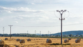 Electricity and hay bales Royalty Free Stock Photos