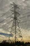 Electricity high-tension. Post with sun morning light Stock Images