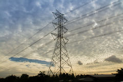 Electricity high-tension post. With sun morning light Stock Images