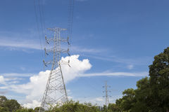Electricity high voltage pole blue sky background. Royalty Free Stock Photography