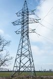 Electricity high voltage power pylon and blue sky in Ukraine. At february Royalty Free Stock Images
