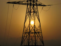 Electricity high voltage tower. Transmission tower at sunset / evening Royalty Free Stock Photography