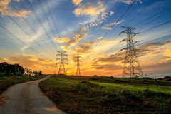 Electricity. A high voltage of transmission tower in the morning sunrise with the beauty of a blue sky Stock Photos