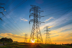 Electricity. A high voltage of transmission tower in the morning sunrise with the beauty of a blue sky Royalty Free Stock Image