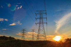 Electricity. A high voltage of transmission tower in the morning sunrise with the beauty of a blue sky Stock Photography