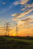 Electricity. A high voltage of transmission tower in the morning sunrise with the beauty of a blue sky Royalty Free Stock Images