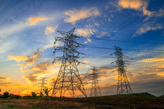 Electricity. A high voltage of transmission tower in the morning sunrise with the beauty of a blue sky Royalty Free Stock Photo