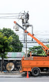 Electricity installation and electrical maintenance services. On aerial and bucket truck equipment for high reach. High-risk occupation Stock Photography