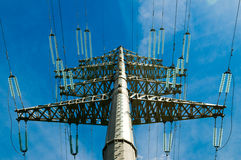 Electricity line. Tall electricity line tower on blue sky Royalty Free Stock Photo