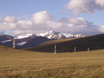 Electricity line in the Tien-Shan highlands. Electricity line in the Tien-Shan highland tundra Royalty Free Stock Photo
